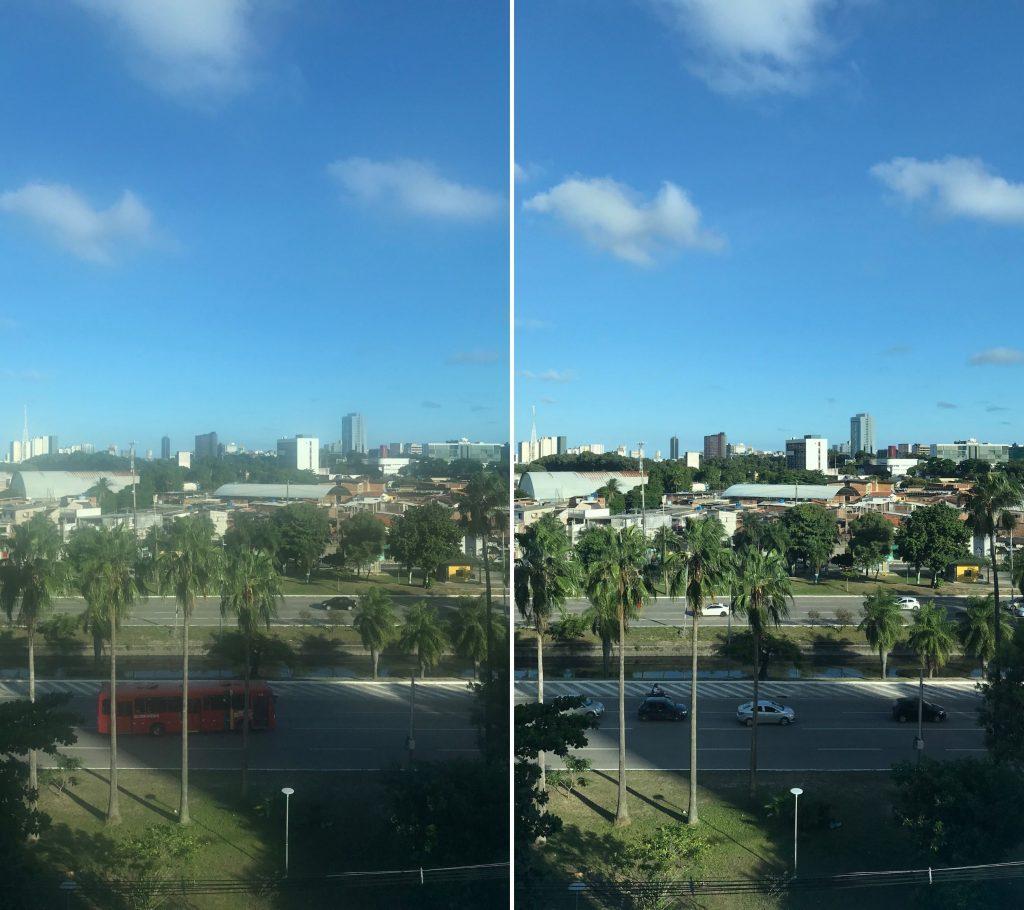 Duas fotos, de uma mesma paisagem, composta por uma avenida onde carros transitam, prédios, árvores e um lindo céu azul, lado a lado comparadas. A primeira, no lado esquerdo, está embaçada e pouco nítida. A segunda, do lado direito, está nítida.